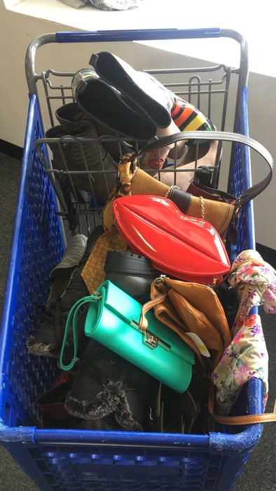 Meetup shopper's cart full of purses