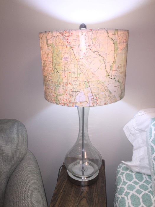 Tim's upcycled lamp placed on a bedside table