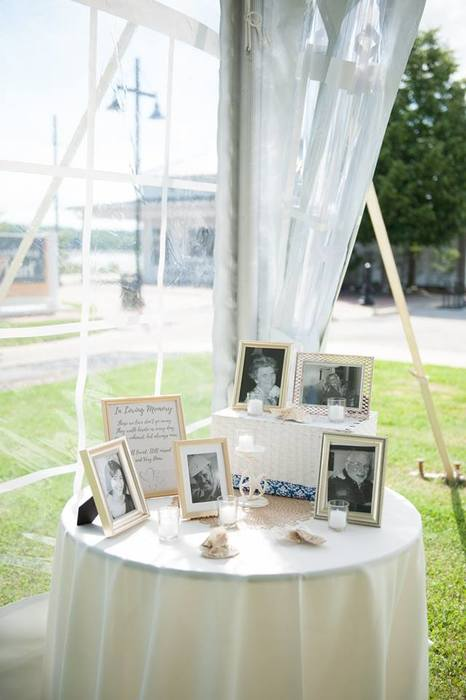 Karen's memory table displayed at her wedding sourced with Goodwill picture frames