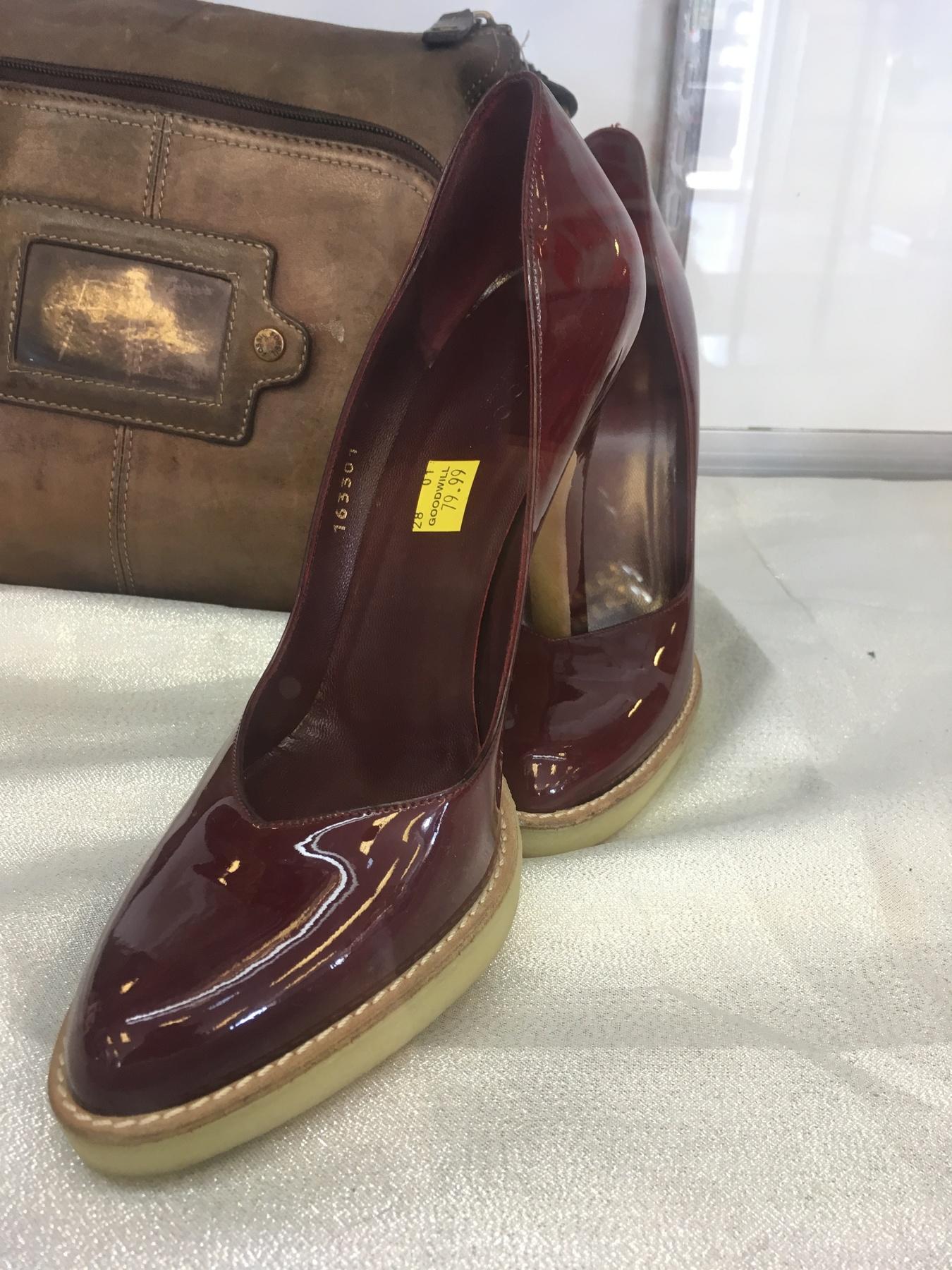 burgundy Gucci pumps found at Waldorf Goodwill