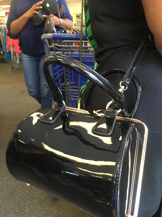 Meetup shopper's patent leather handbag found at Clinton Goodwill