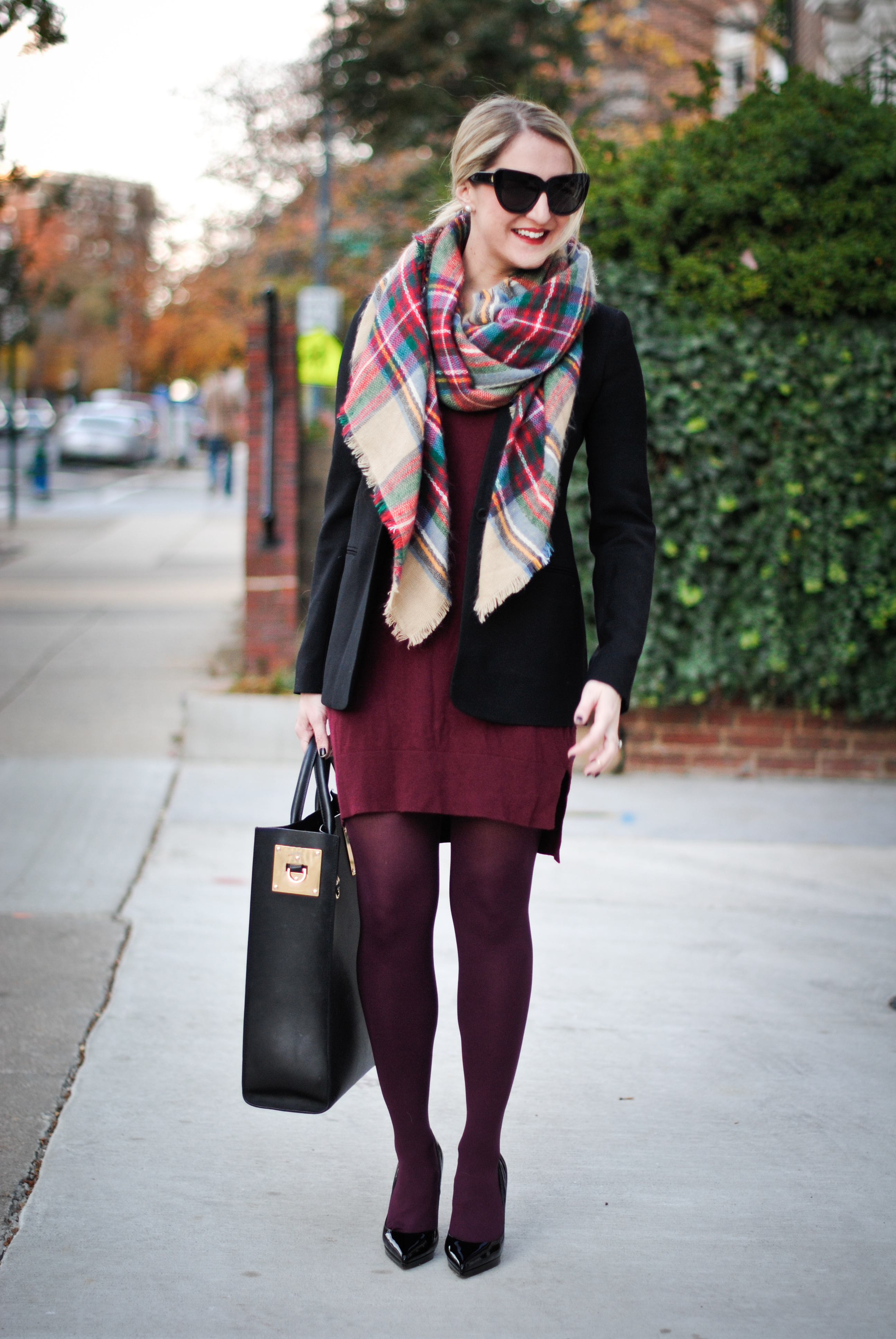 woman wears a burgundy tights with a casual ensemble