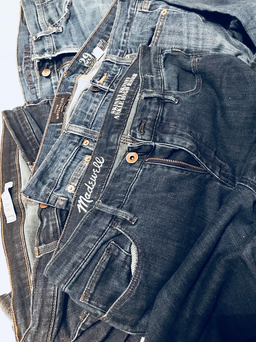 Karen's Madewell jeans from Goodwill and an assortment of other pairs of jeans.