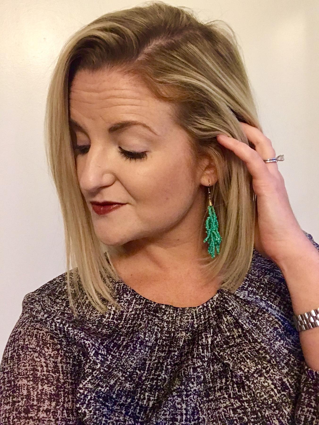 Karen models her beaded earrings found at Goodwill.