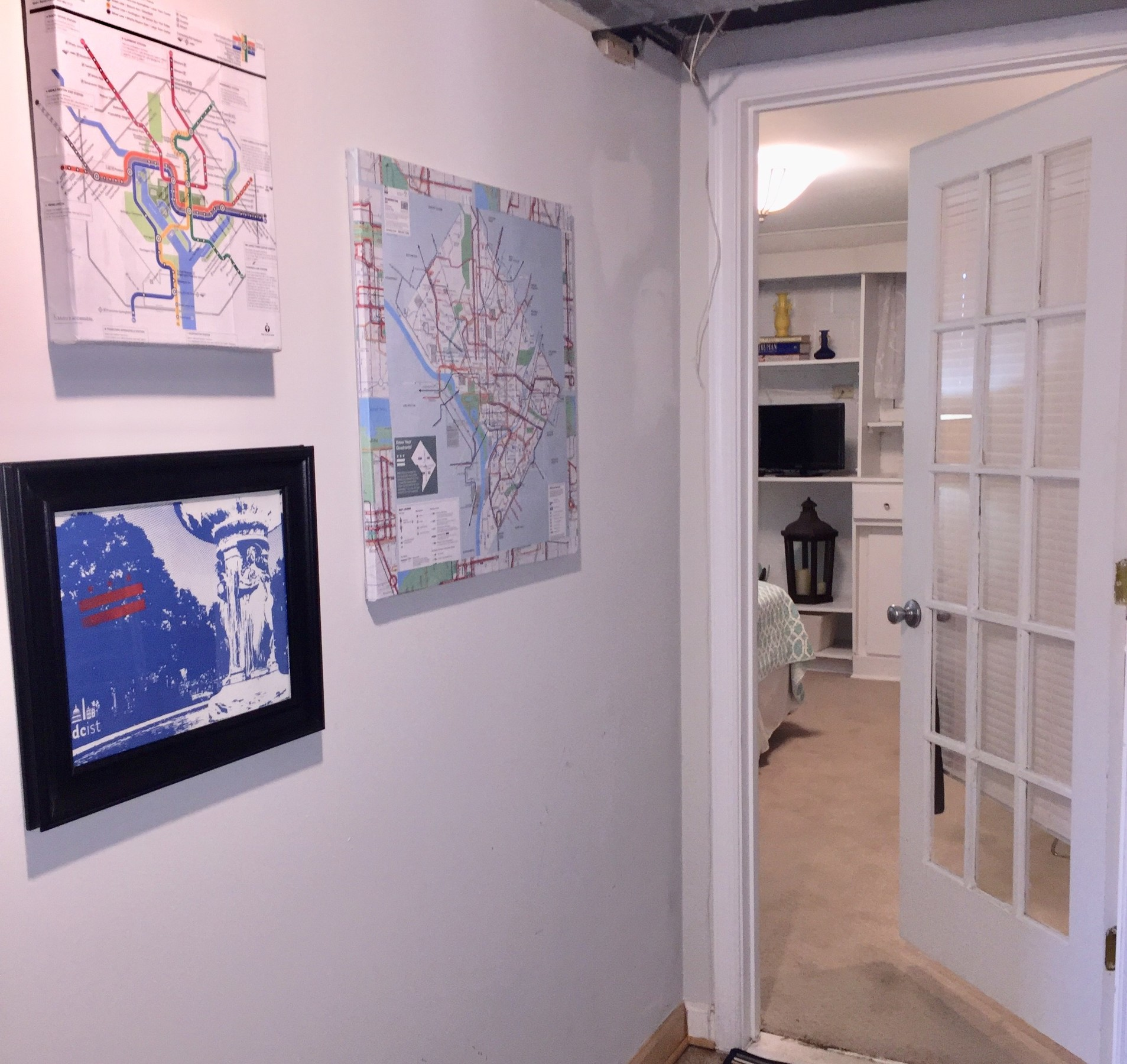 "Tim displays his completed ""map artwork"" in a home setting."
