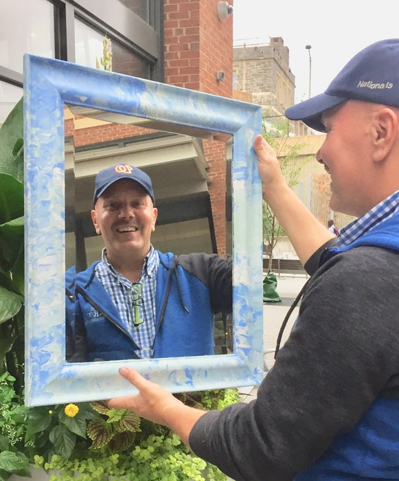 Tim Kime's reflection in an upcycled mirror