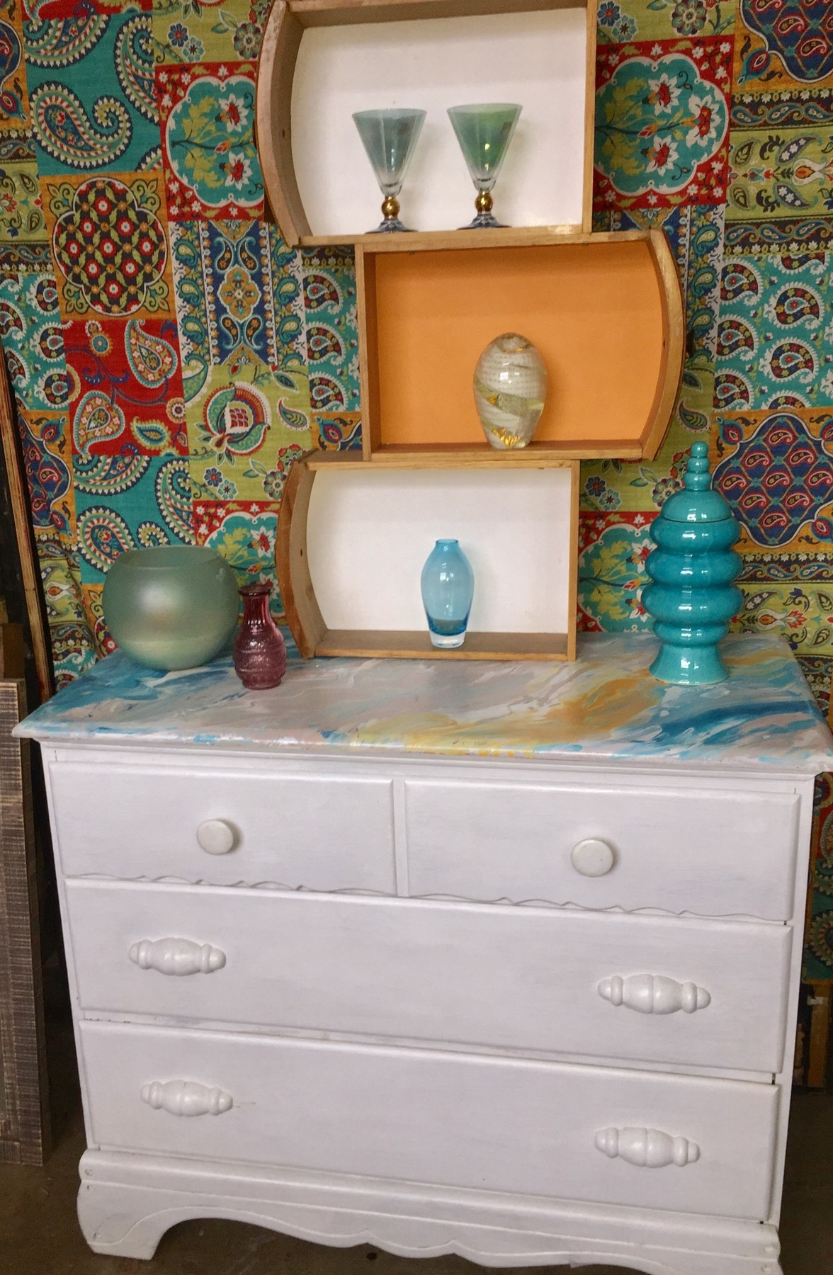 Tim's painted dresser adorned with stylish accessories
