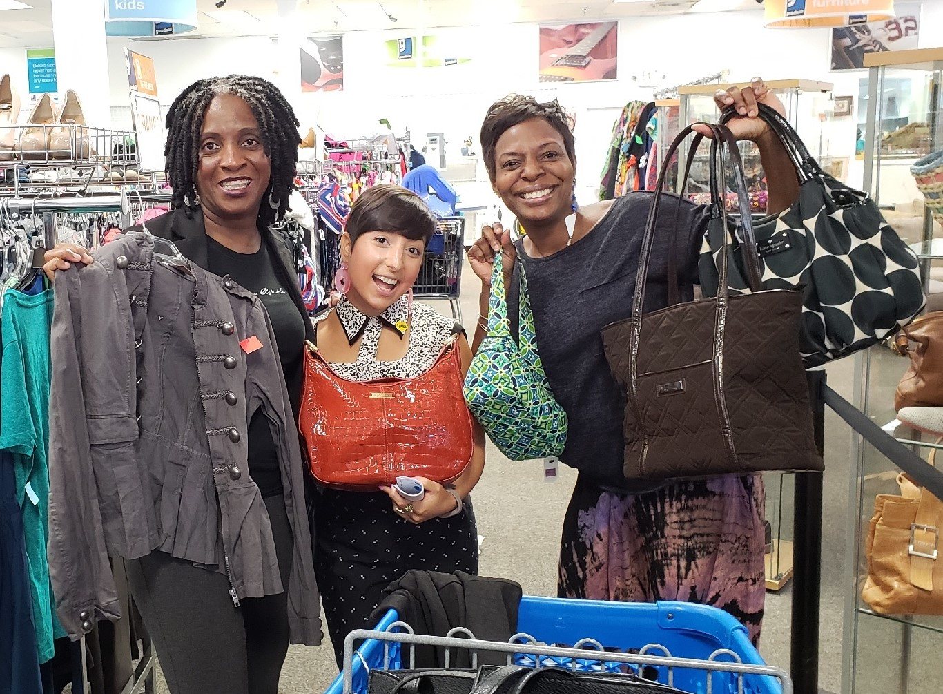 Carolyn poses with Meetup shoppers at Richmond Highway Goodwill store