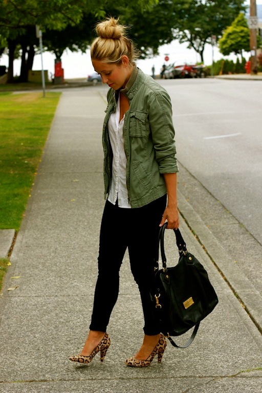 woman wears green utility jacket with black pants and leopard print pumps