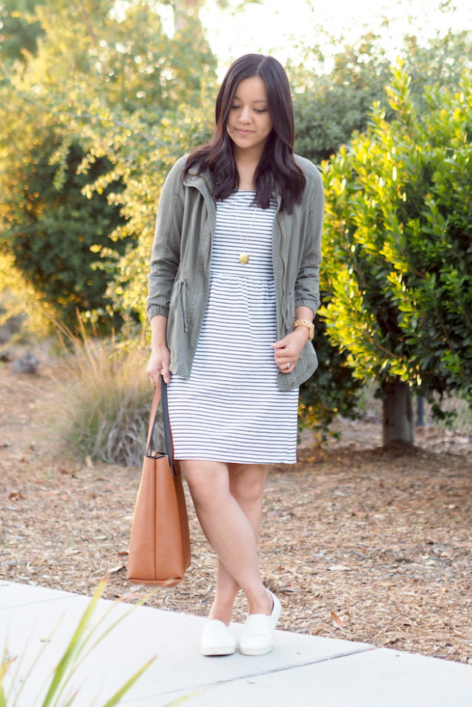 woman wears green utility jacket and shift dress