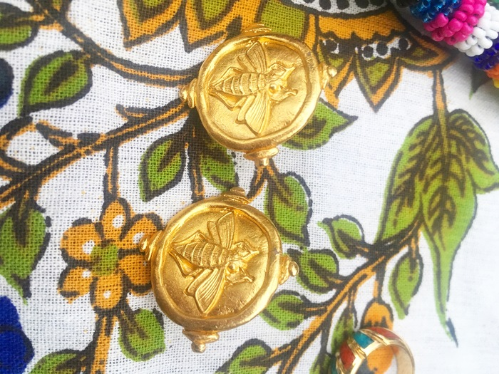 Carolyn's gold earrings found at Goodwill