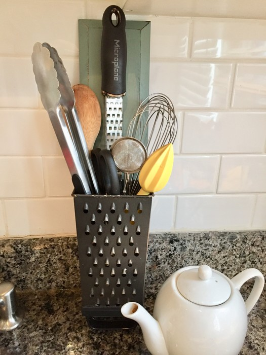 Tim's upcycled grater used to hold cooking utensils