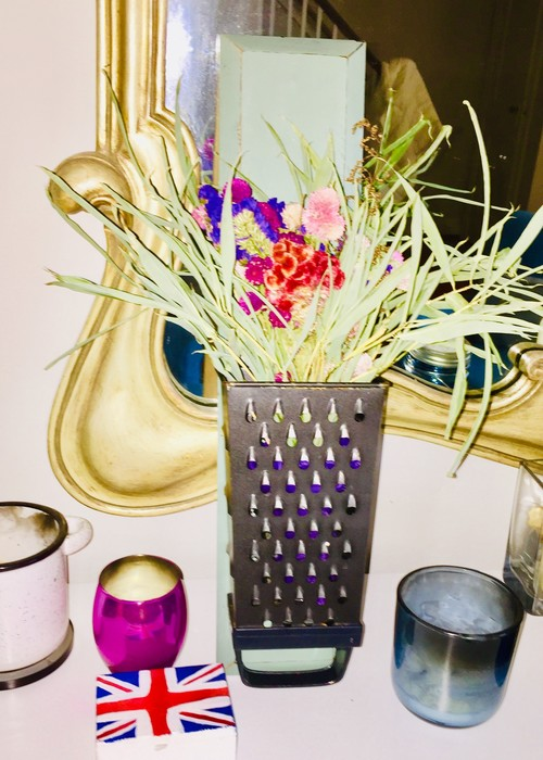 Tim's upcycled grater used to hold a floral arrangement