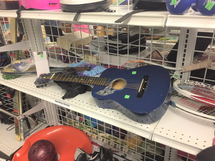 Tim's guitar found at Goodwill retail store