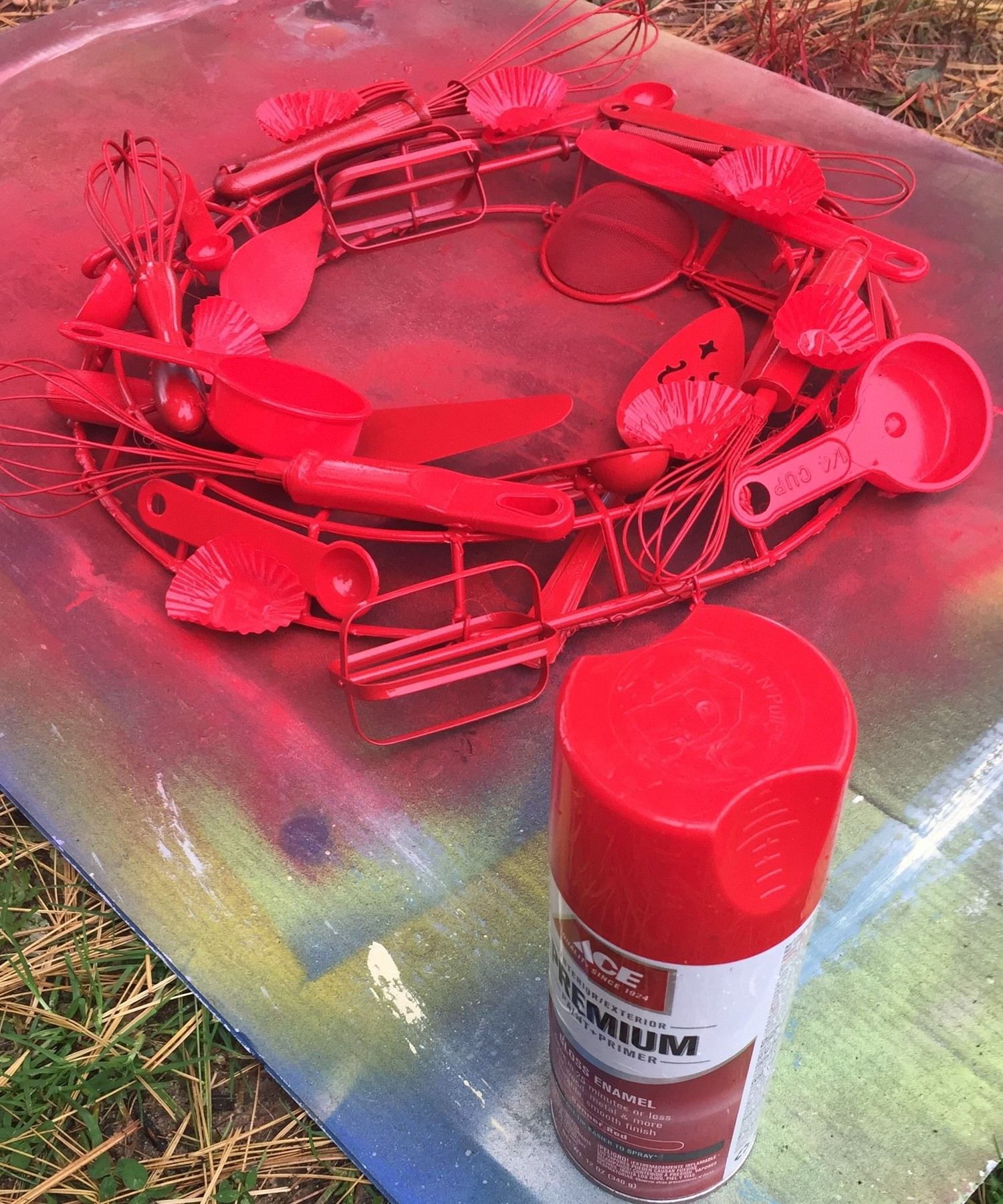 Tim's utensil wreath spray painted red.