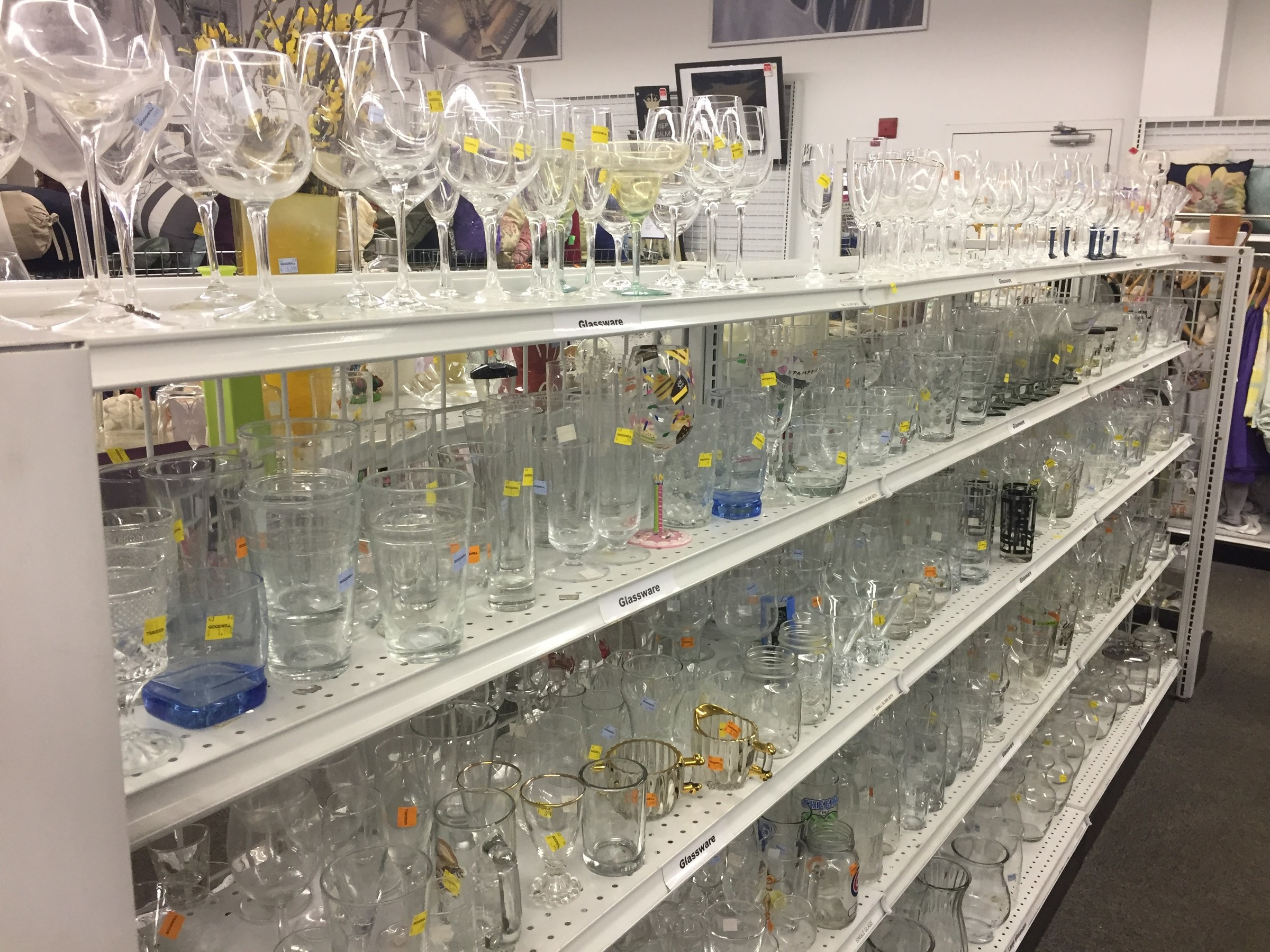 wine glass section at Goodwill store