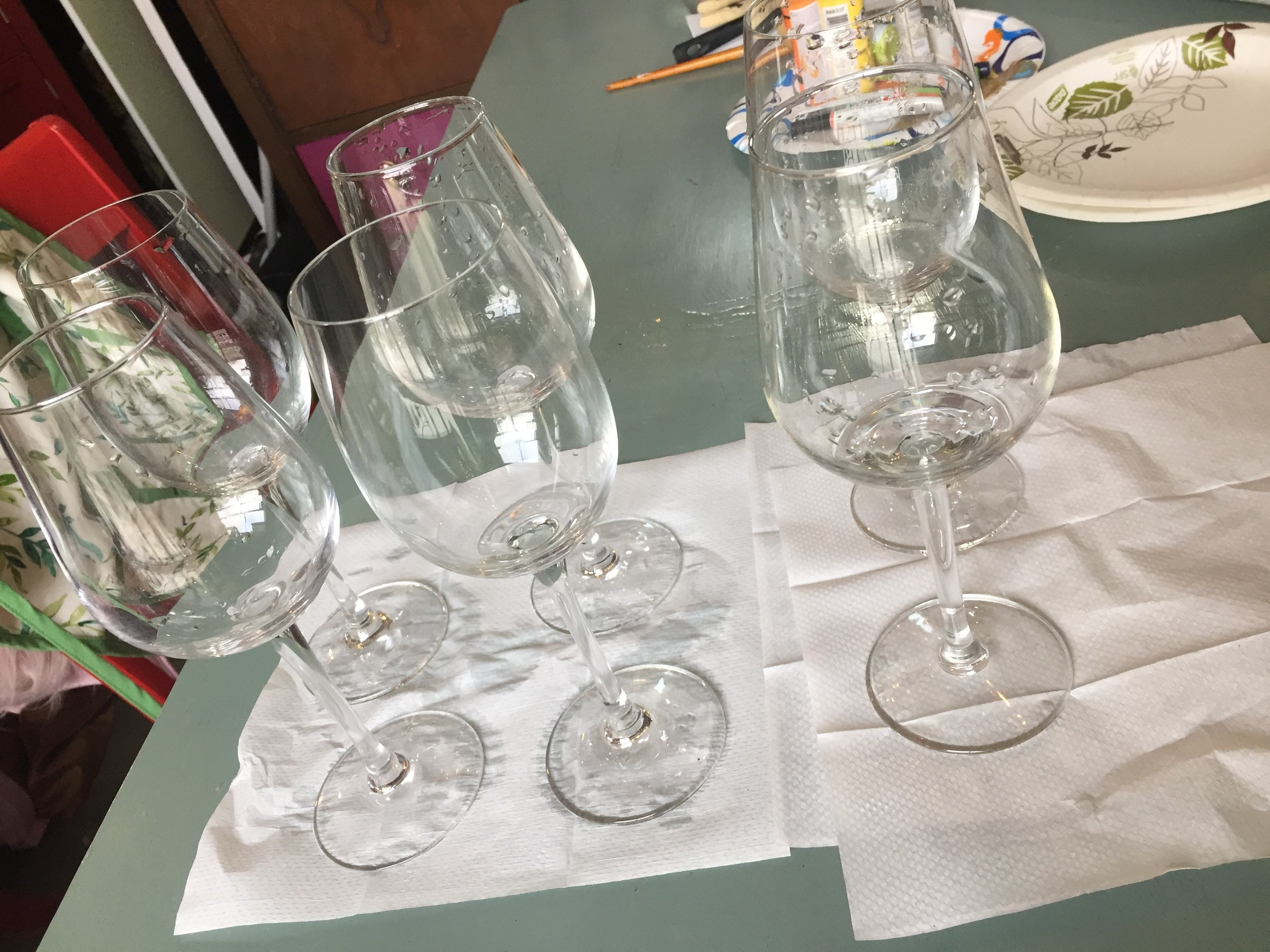 Tim's Goodwill wine glasses, washed and drying on paper towel